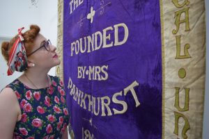 Helen Antrobus with the Manchester suffragette banner, 1908 @ People's History Museum