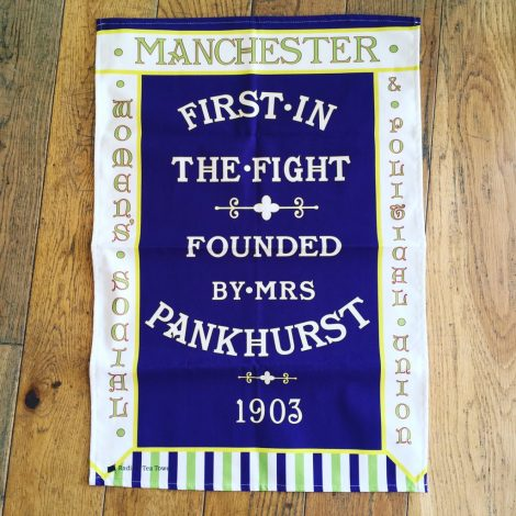 Manchester suffragette banner tea towel @ PHM shop