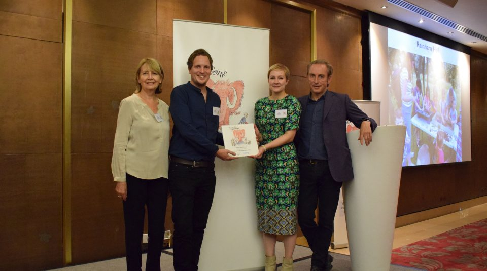 Kay Carberry (Trustee), Mike Prescott and Liz Thorpe from People's History Museum, collect the Family Friendly Museum Award from Kids in Museums President, Philip Mould