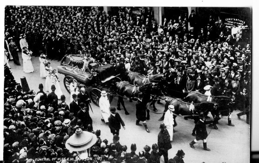 Emily Wilding Davidson's funeral procession in Hart Street, as it approached St George's Church in Bloomsbury, London © Elizabeth Crawford