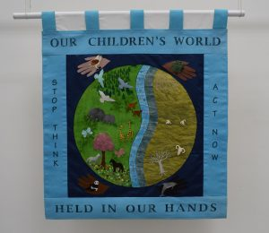 Our Children's World Held In Our Hands banner, 1996. Image courtesy of People's History Museum