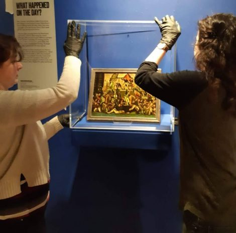 Left to right Sam Jenkins, Collections Officer and Kloe Rumsey, Conservator installing objects in Changing Exhibitions Gallery @ People's History Museum