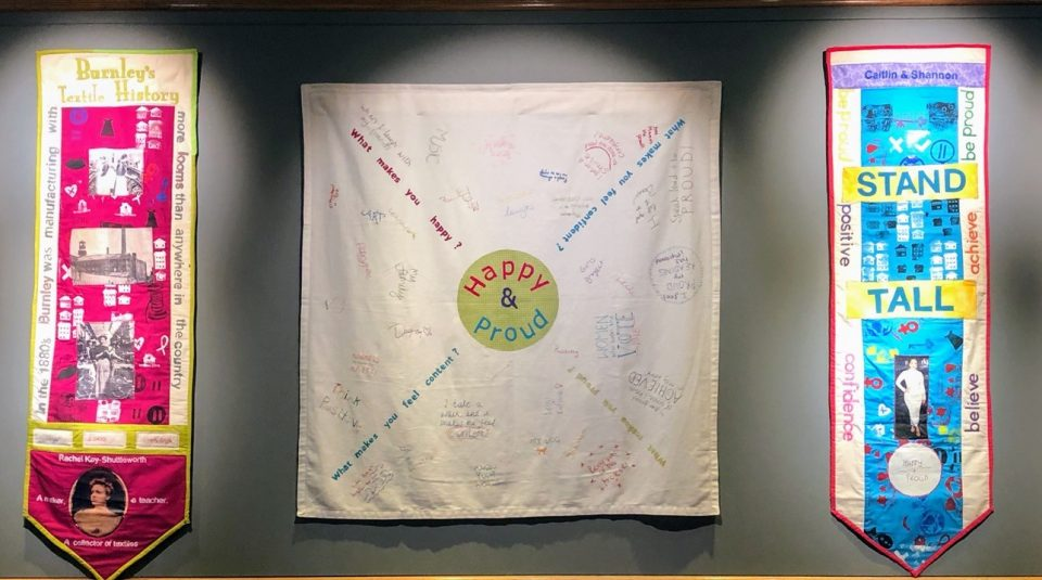 Happy and Proud project banners and bags, designed and made by project participants on display at Burnley Mechanics and the National Trust's Gawthorpe Hall ©Participation Works NW