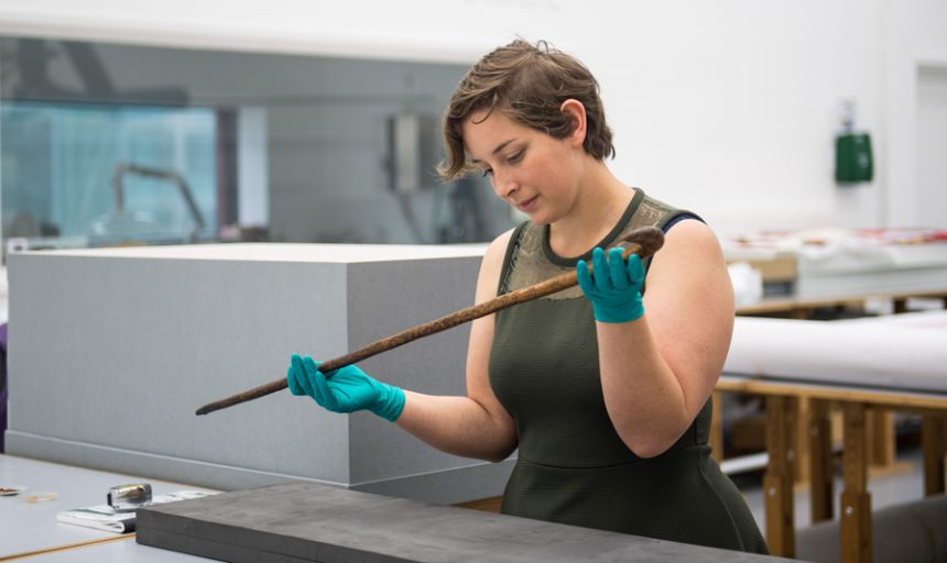 PHM Collections Officer Sam Jenkins with Peterloo cane, around 1819 © People's History Museum