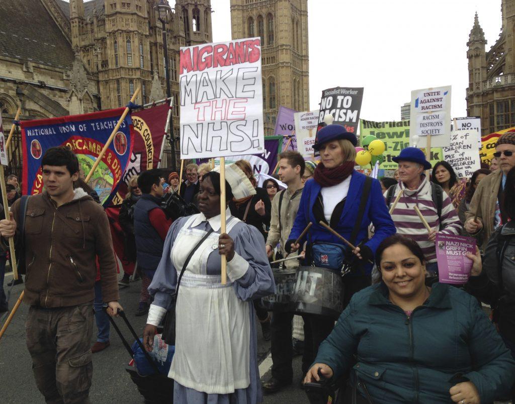 Migrants make the NHS, showing RAPAR activist Manjit Kaur, Anti Racist Day march © Mark Krantz