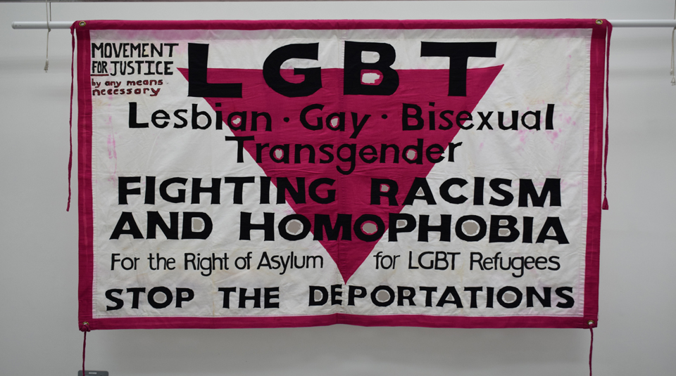11 February 2021, Migration, Race & Empire LGBT+ histories tour, OUTing the Past Festival with People's History Museum. Movement for Justice banner by Ed Hall