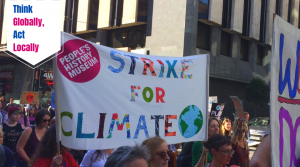 13 May 2021, Radical Late online - Think Globally, Act Locally: Space to Imagine, Time to Act with People's History Museum. Image of PHM staff on Global Climate Strike, Manchester, 20 September 2019, courtesy of People's History Museum
