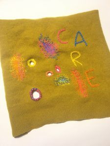 Textile piece with visible signs of mending
