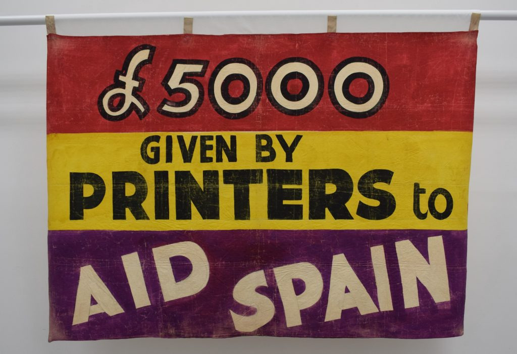 £5000 Given by Printers to Aid Spain banner, around 1937. Image courtesy of People's History Museum