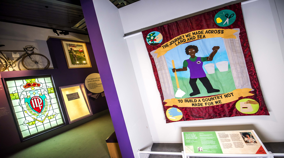 The Journey Across Land And Sea, To Build A Country Not Made For Me banner (2021), Migration a human story at People's History Museum