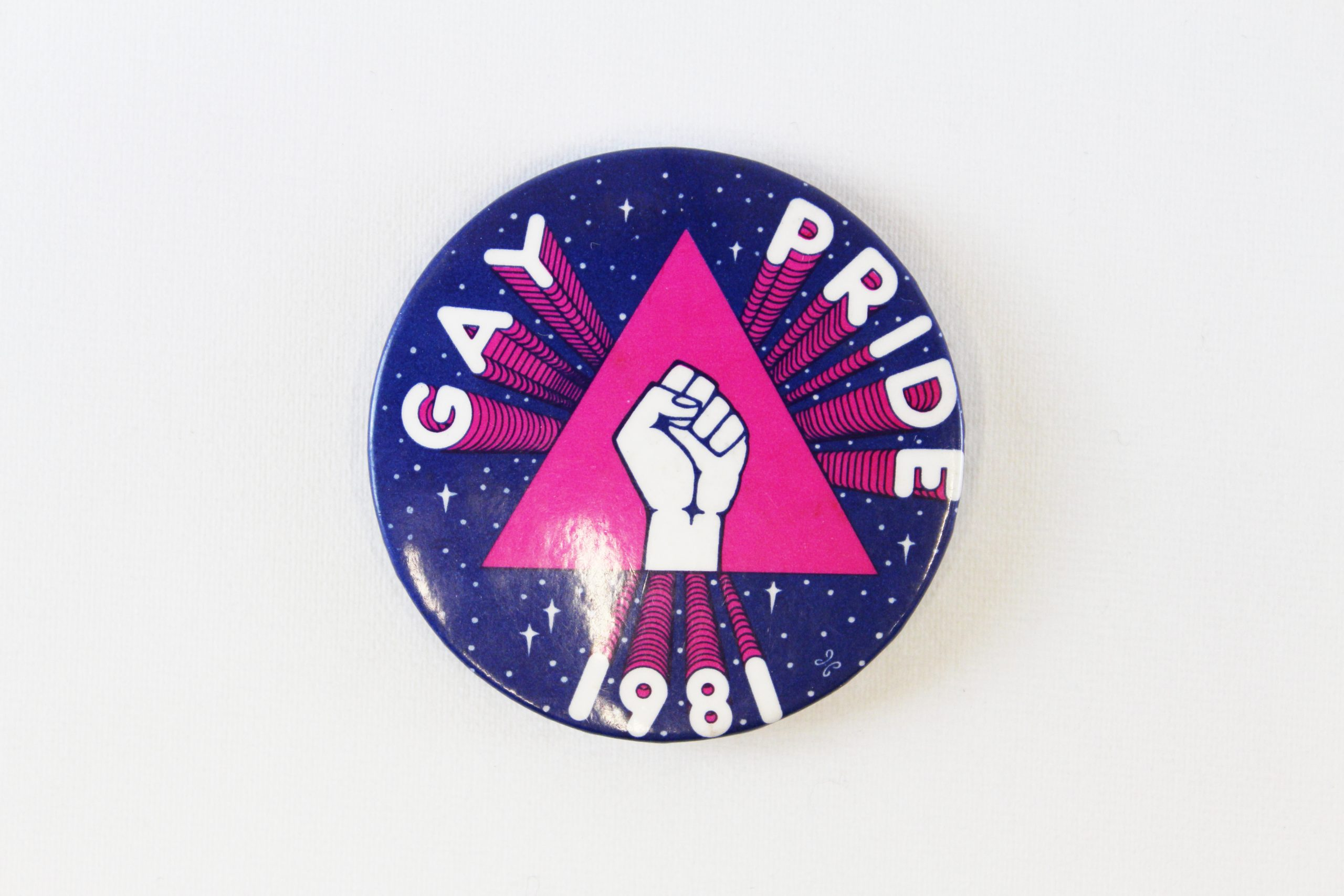Gay Pride badge, 1981 with raised fist motif in centre. From the collection of People's History Museum